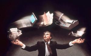 office worker juggling technology